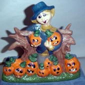 scarecrow with nine pumpkins
